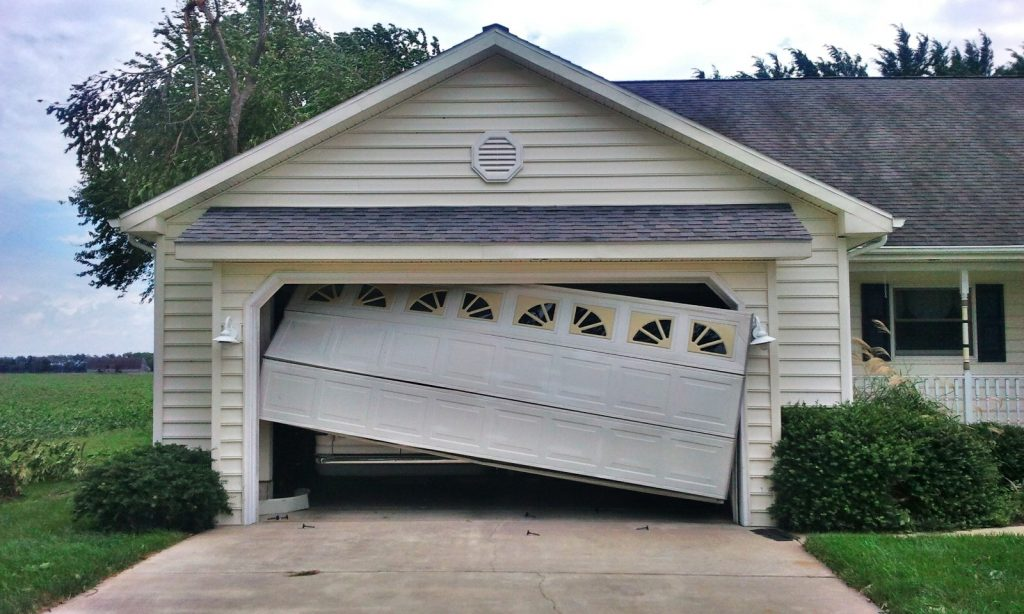 Residential garage door that's broken and needs to be replaced