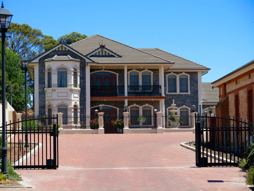 New driveway gate that's been installed at a large mansion home.